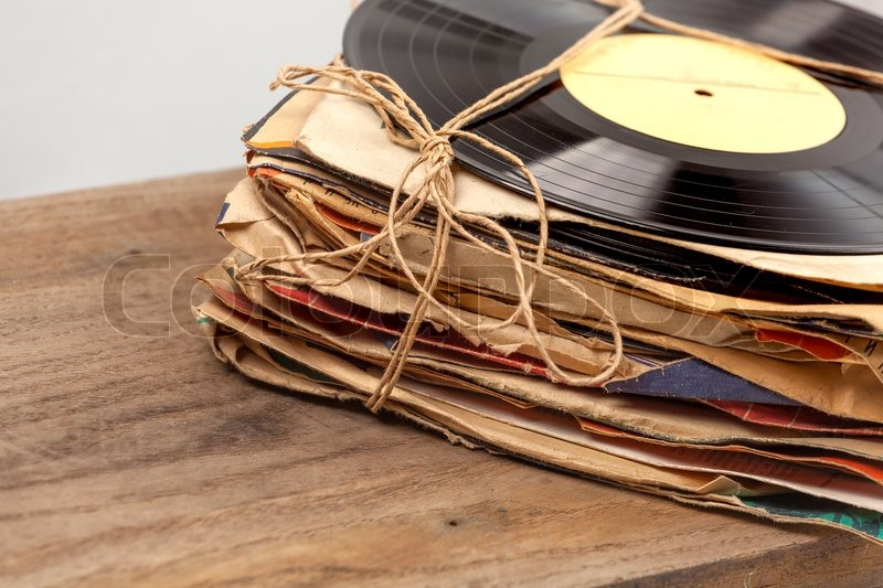 Stack of old vinyl records tied with rope stock photo for What to do with old vinyl records