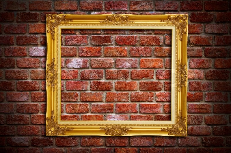 Gold Frame On Old Brick Wall Background Stock Photo