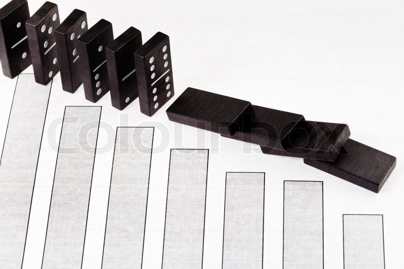 Fallen Domino And Reduced Sales Diagram Stock Photo
