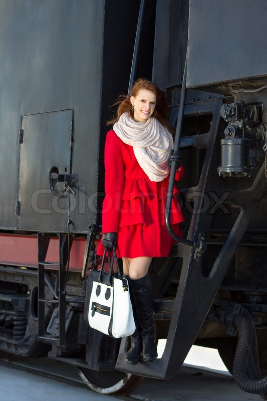 Beautiful woman in red coat and vintage train | Stock Photo ...