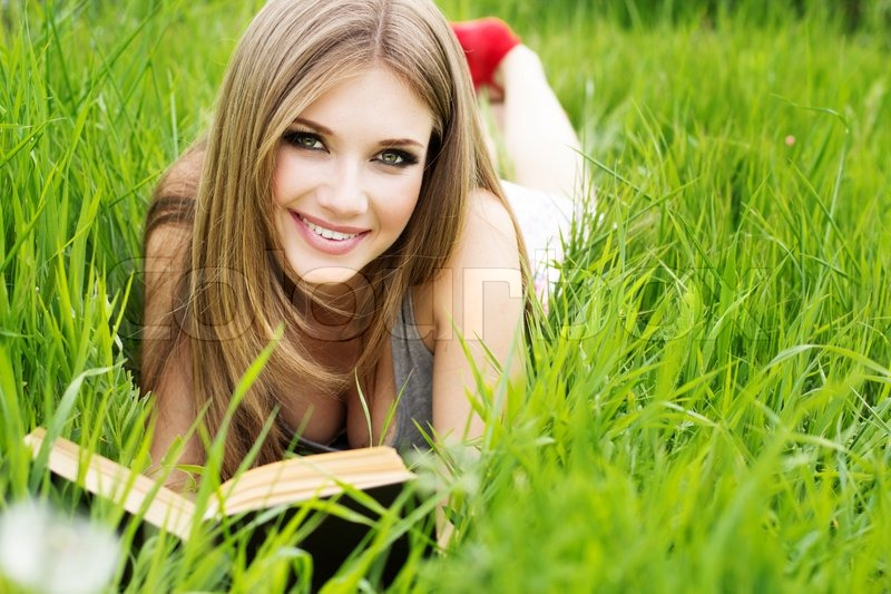 6728519-925973-young-woman-lies-on-green