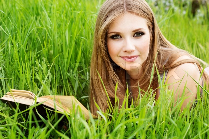 6728557-926327-young-woman-lies-on-green