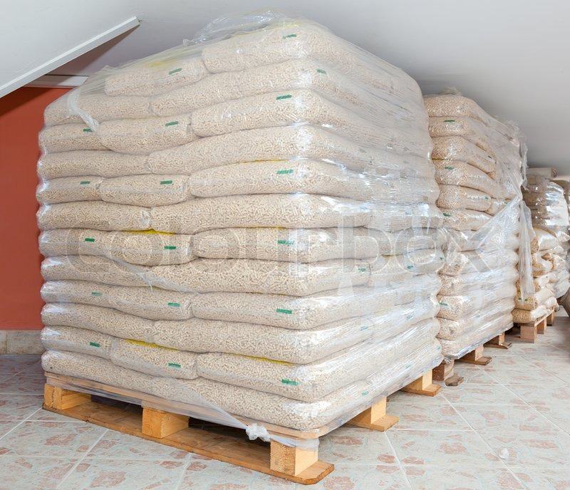 Pallets Of Wood Pellets In Plastic Bags Stock Photo