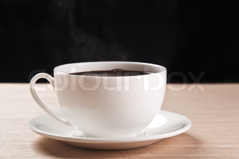 White cup of coffee on black background, stock photo