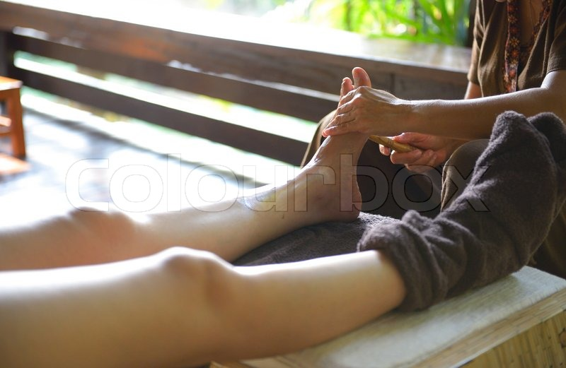 The women massage her foot for thai spa foot massage, stock photo