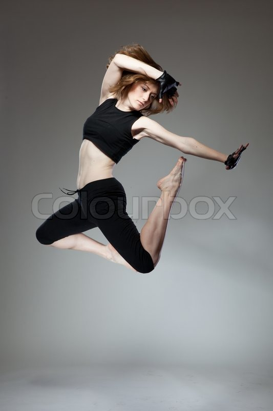 Attractive jumping woman , stock photo