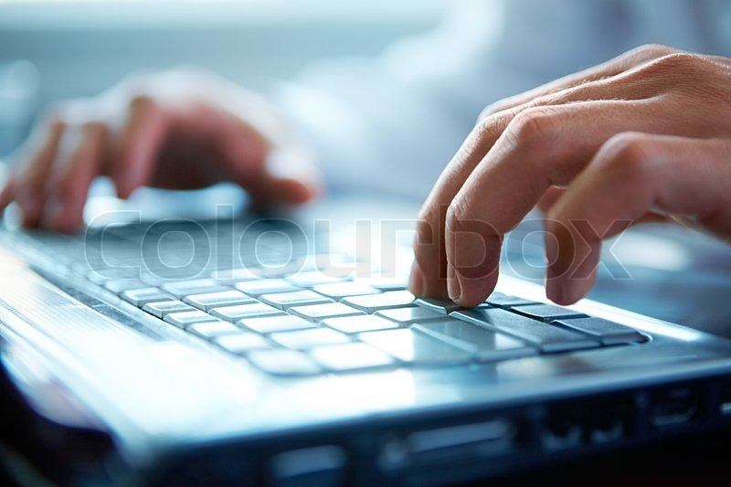 Stock image of 'Close-up of typing male hands '