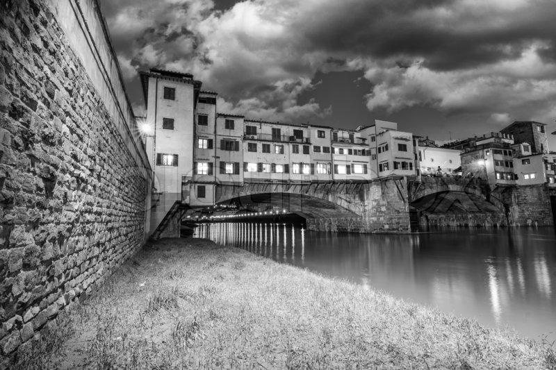 Ponte vecchio over arno river florence italy stock photo