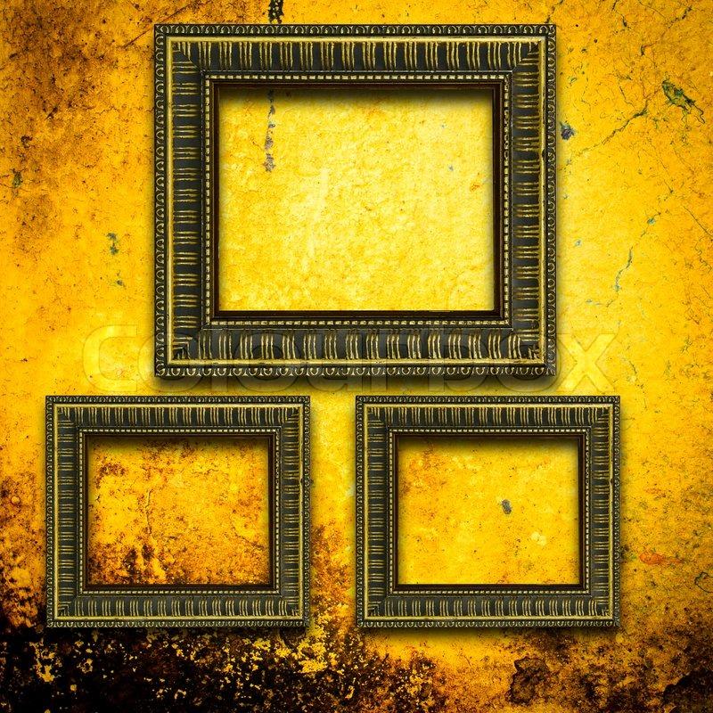 Retro wooden frames over gold grunge wallpaper   Stock Photo   Colourbox