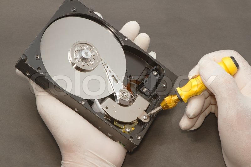 Hand with gloves repairs hard drive ,data recovery concept, stock photo