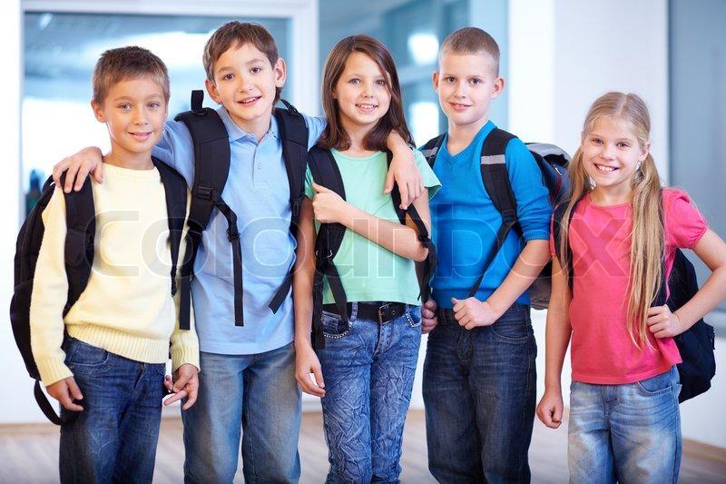 Portrait Of Smart Schoolkids Standing Stock Photo Colourbox