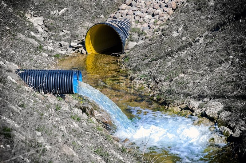 Waste Water Pipe Polluting Environment Stock Photo