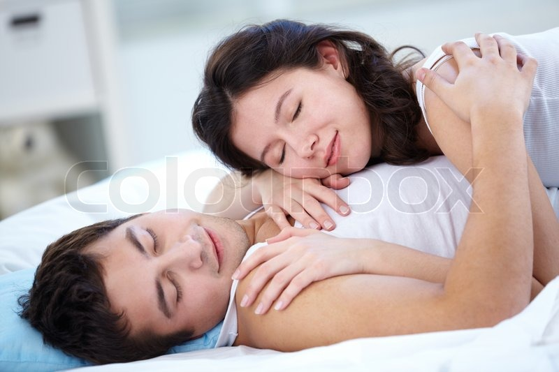 Lovers Sleeping Together In Bed