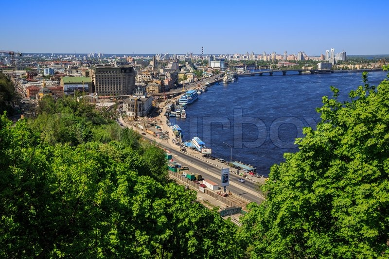 Panorama of city landscape and nature. Kiev, Ukraine. Green trees, architecture, bridges and blue river, stock photo