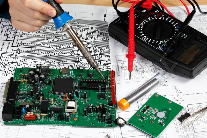 Repair and diagnostic of electronic     | Stock image