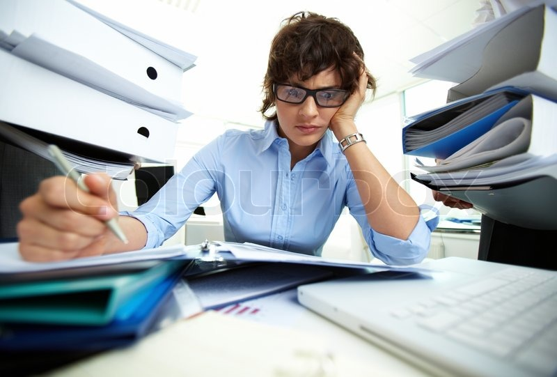 Pile Of Reports : Perplexed accountant doing financial reports being