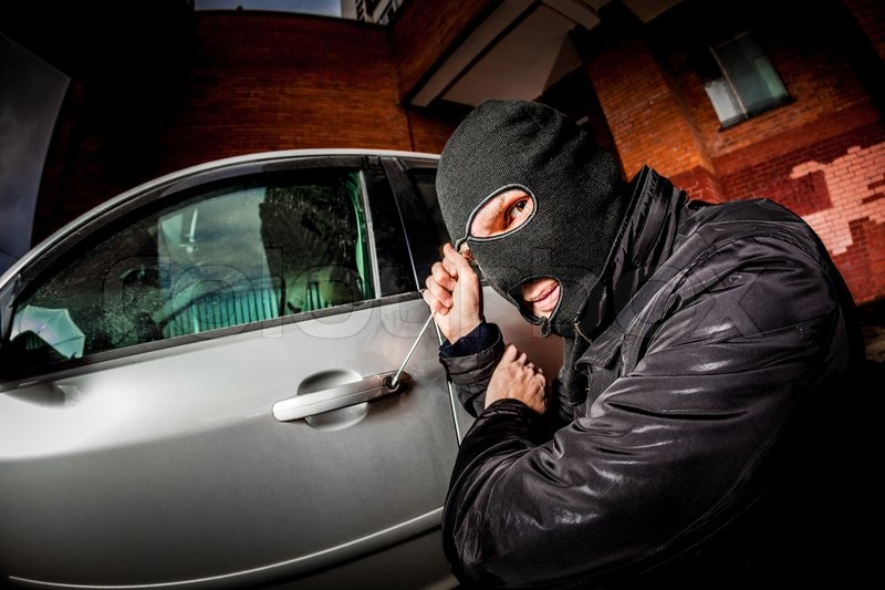 Online Auto Insurance >> Robber and the car thief in a mask ... | Stock Photo ...