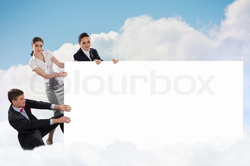 Small group of people holding a blank banner, place for text, stock photo