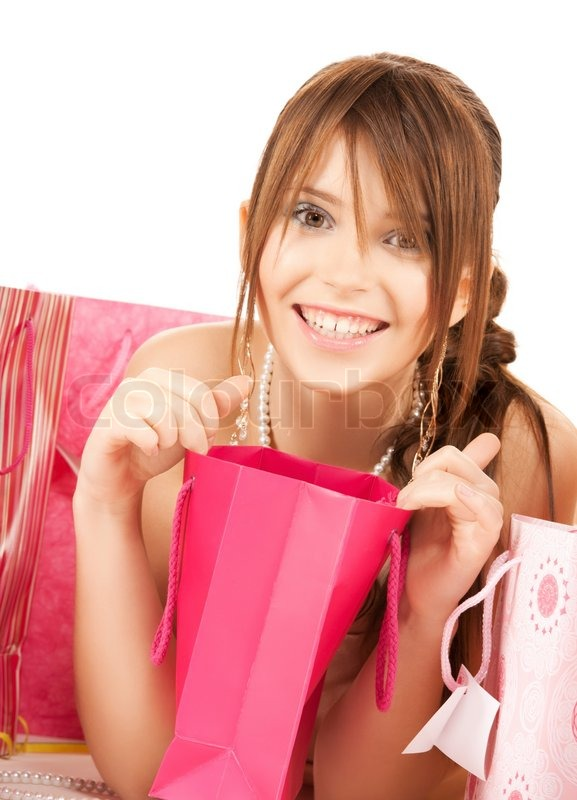 Picture of happy girl with colorful gift bags, stock photo - 6867740-girl-with-colorful-gift-bags