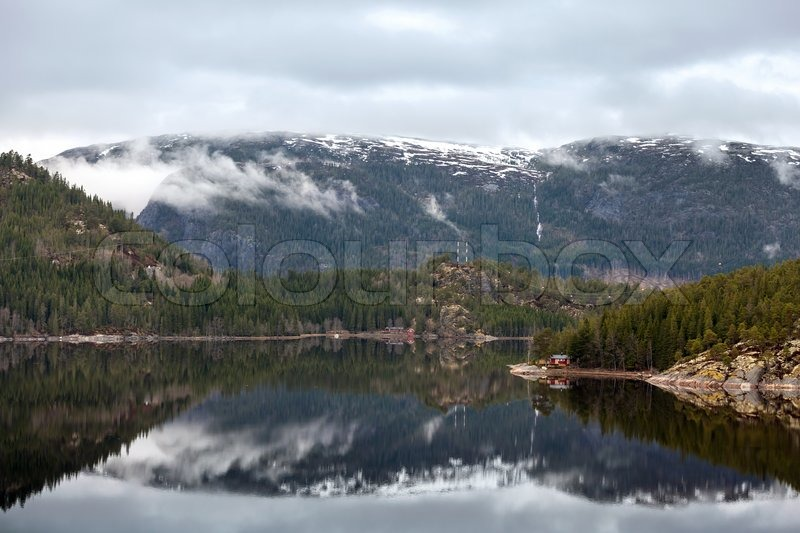 Norwegian landscape with calm sea water and mountains stock photo colourbox - The house on the rock the ultimate refuge in a norwegian fjord ...