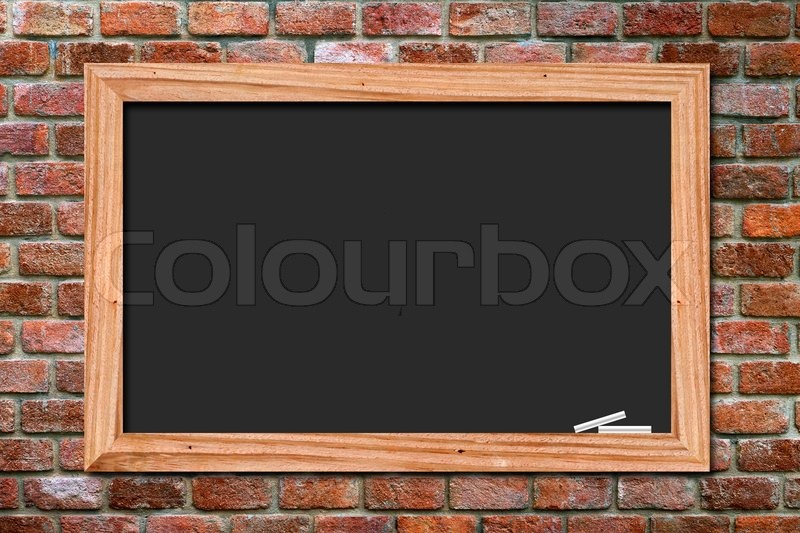Blackboard on old brick wall background, stock photo