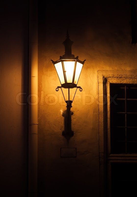 Old Street Lamp Light On The Wall At Stock Photo
