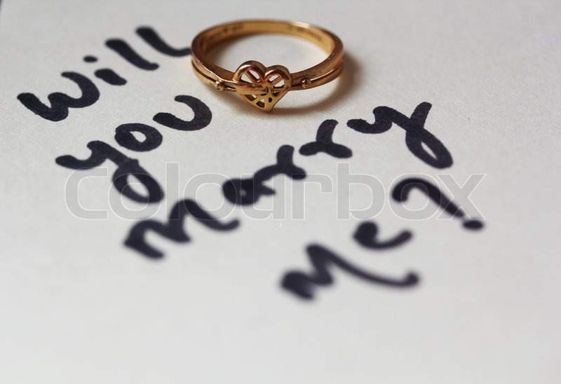 Will you marry me Proposal text written with heart shaped wedding