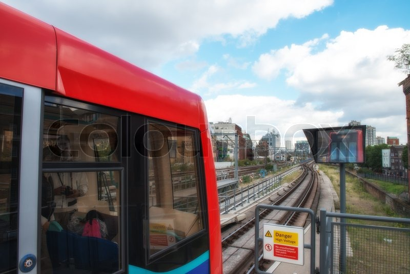 Red train of London public transportation - UK, stock photo