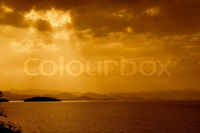 Rays of sun shining through the clouds over the Lake, stock photo