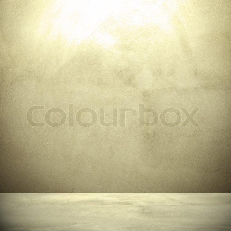Concrete wall background in retro style, with hightlight on the top, stock photo