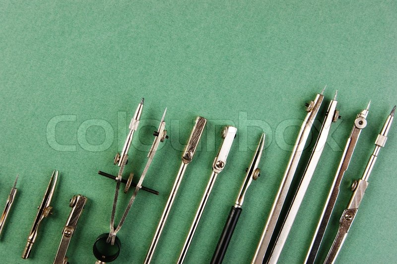 Old drawing tools on a green background, stock photo