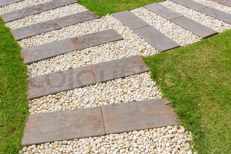 Beautiful stone and wood path in garden, stock photo