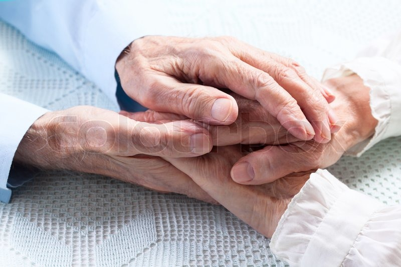 Old people holding hands. Closeup. | Stock Photo | Colourbox