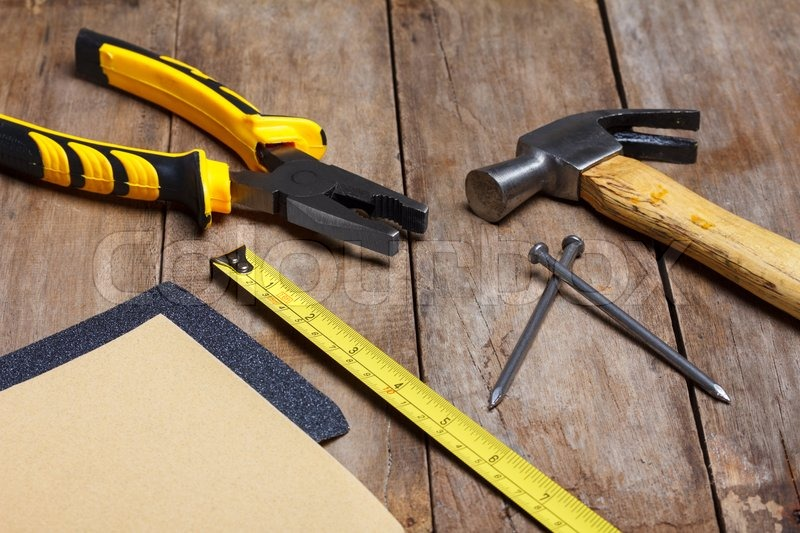 Construction Instruments On Wooden Table Sandpaper