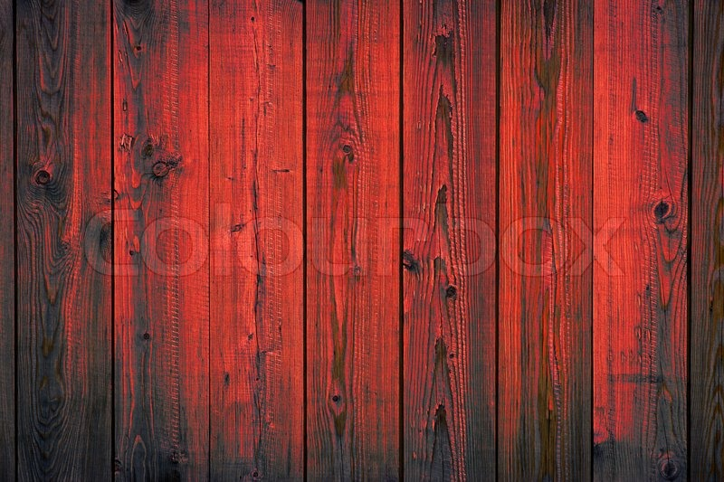 Grunge painted wooden red paint peeling off planks texture