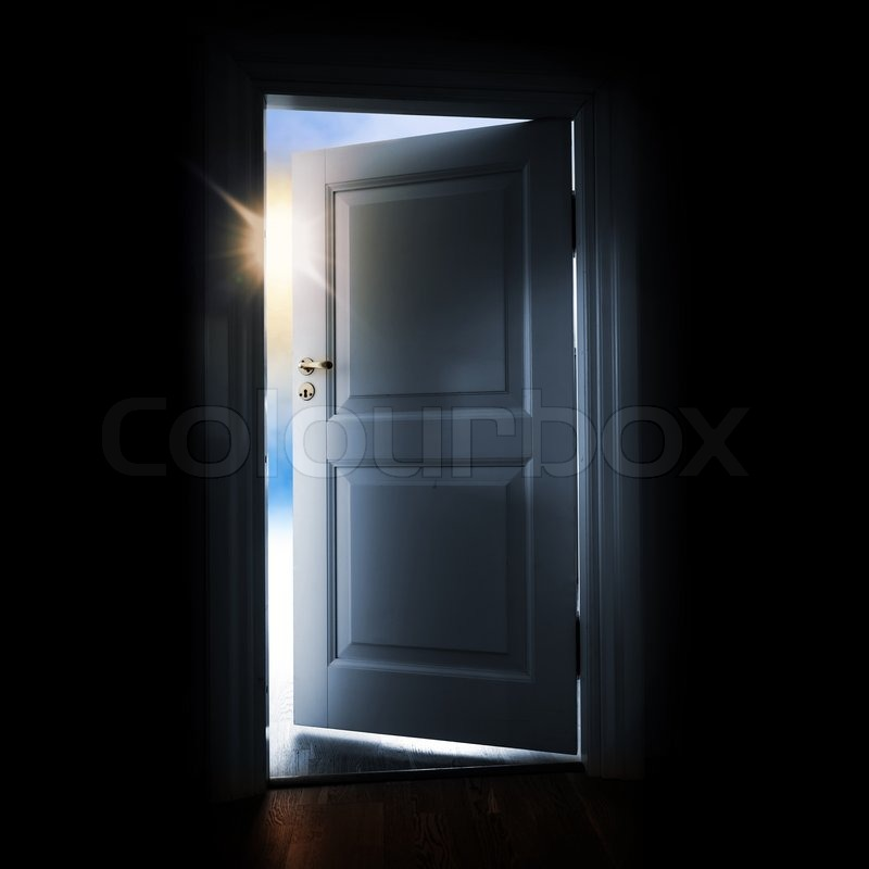 Opening Blue Door In A Dark Room With Shining Light And