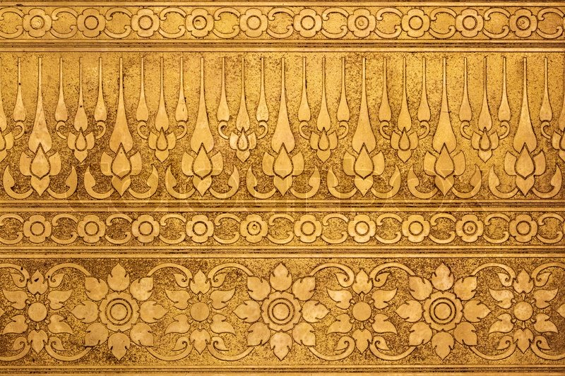 Old gold metal plate with thai traditional carving in