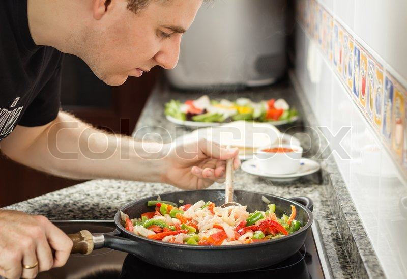 Handsome Man Cooking Vegetables And Chicken For A Mexican