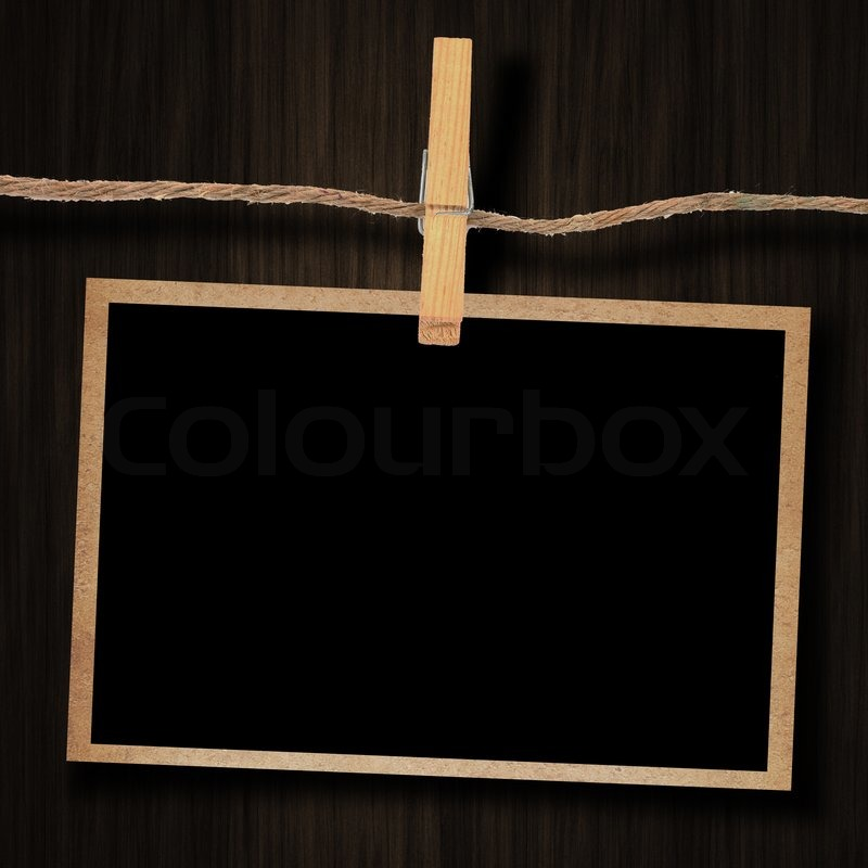 Old photo and clothes peg wood background, stock photo