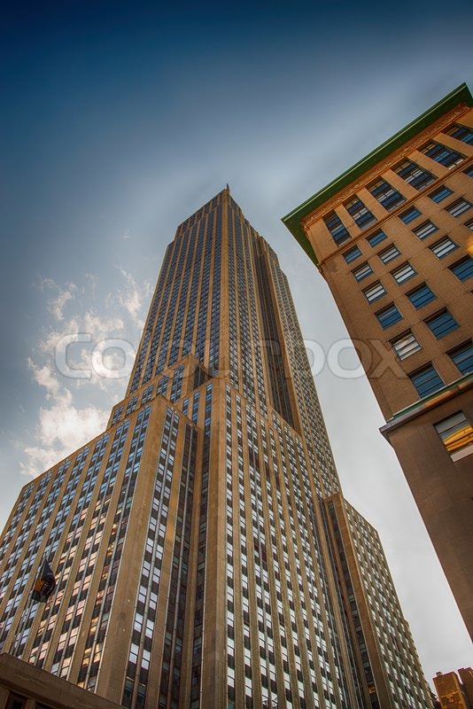 NEW YORK CITY - JUN 12: The Empire State Building high in the summer sky, June 12, 2013 in New york City. It stood as the world\'s tallest building for more than 40 years from 1931 to 1972, stock photo
