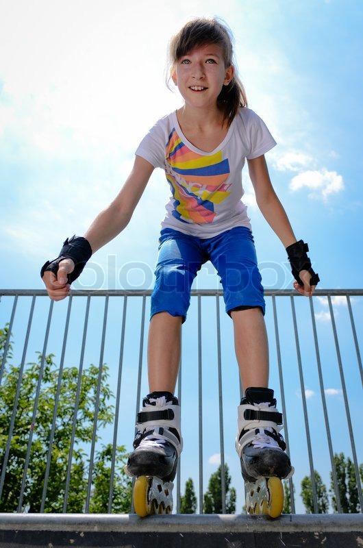 Girl Roller Skating In Park Stock Photo - Image: 49186514