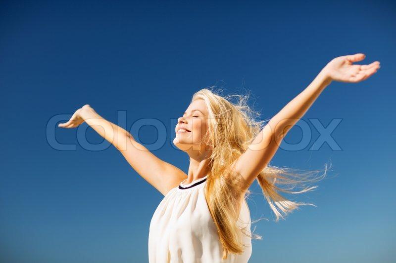 Lifestyle concept - beautiful happy woman enjoying summer outdoors, stock photo