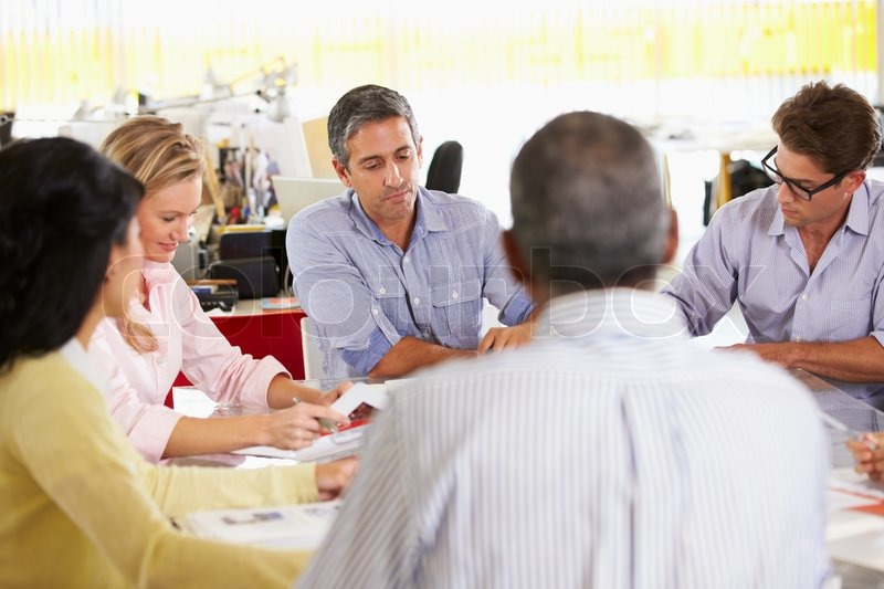 Team Meeting In Creative Office, stock photo