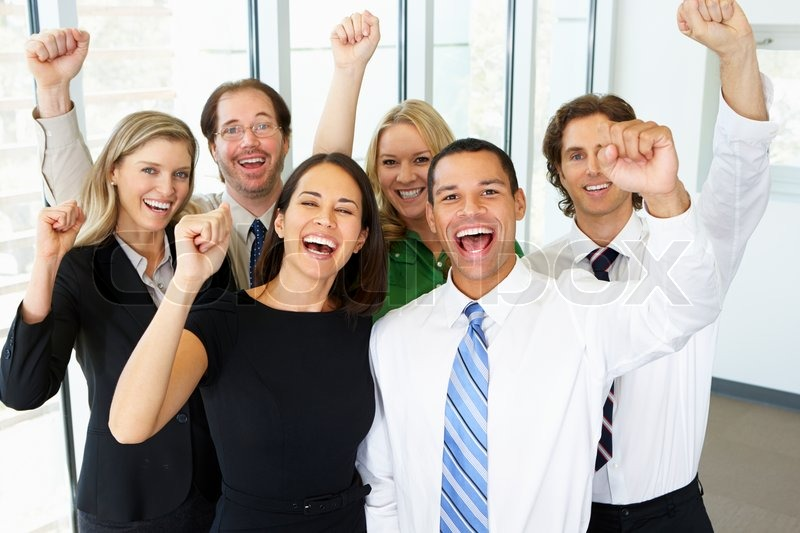 Stock image of 'Portrait Of Business Team In Office Celebrating'