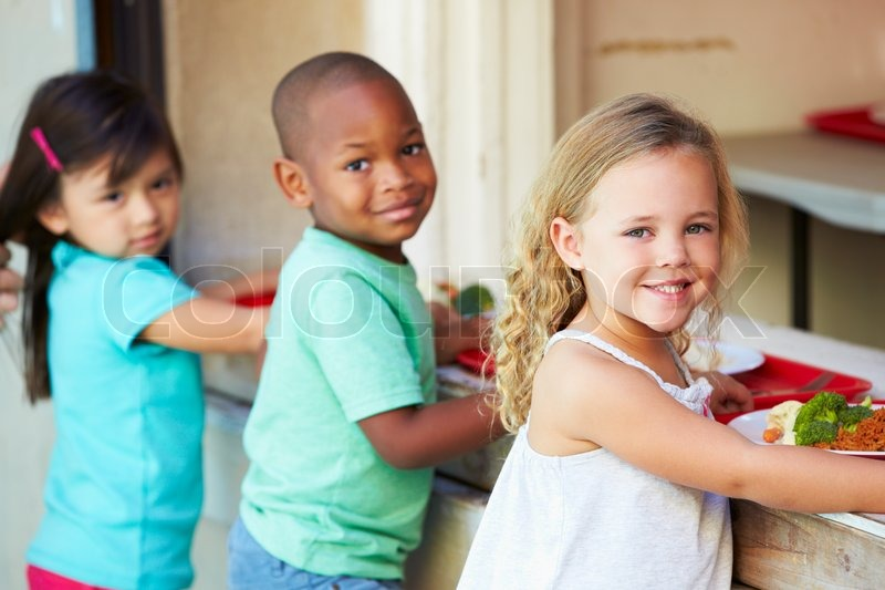 Elementary Pupils Collecting Healthy Lunch In Cafeteria, stock photo