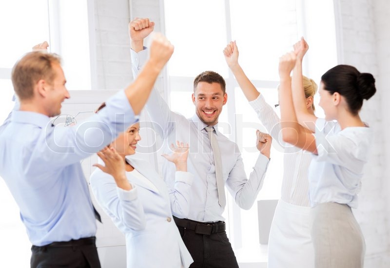 Picture of happy business team celebrating victory in office stock photo colourbox - Office photo ...