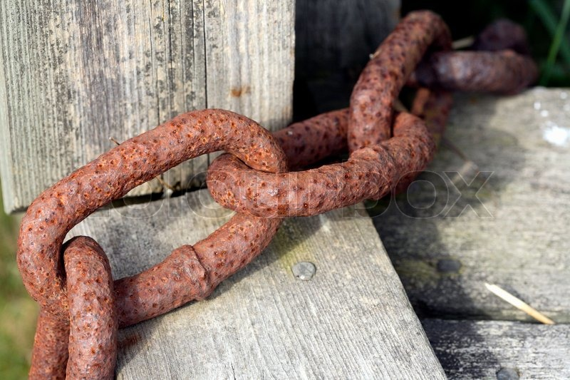 Close Up Of Some Links Of A Rusty Chain On Grey Weathered