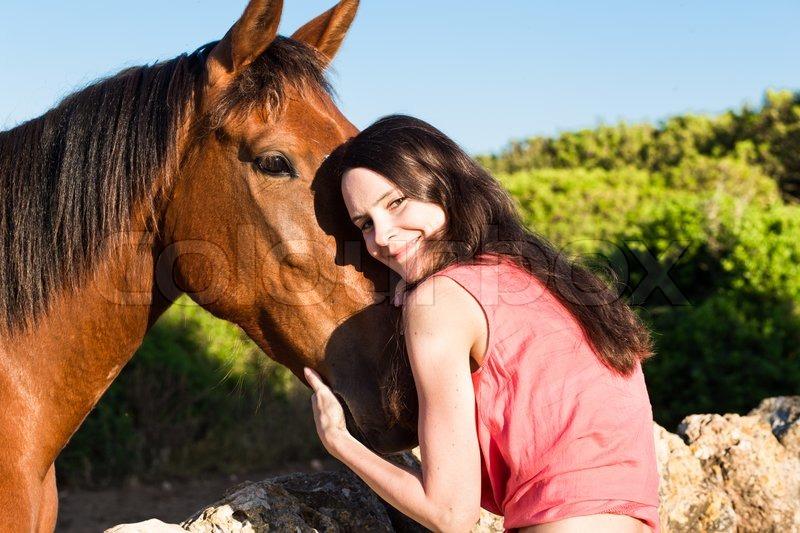 schöne mädchen und ein pferd  stockfoto  colourbox