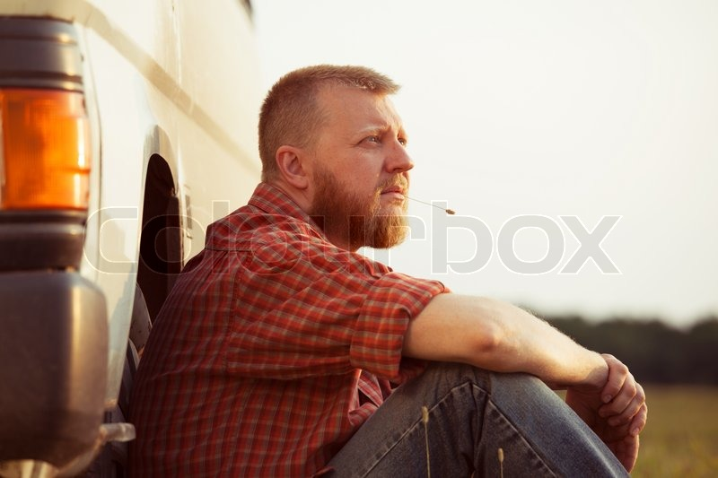Red-bearded man in jeans on a summer evening, stock photo