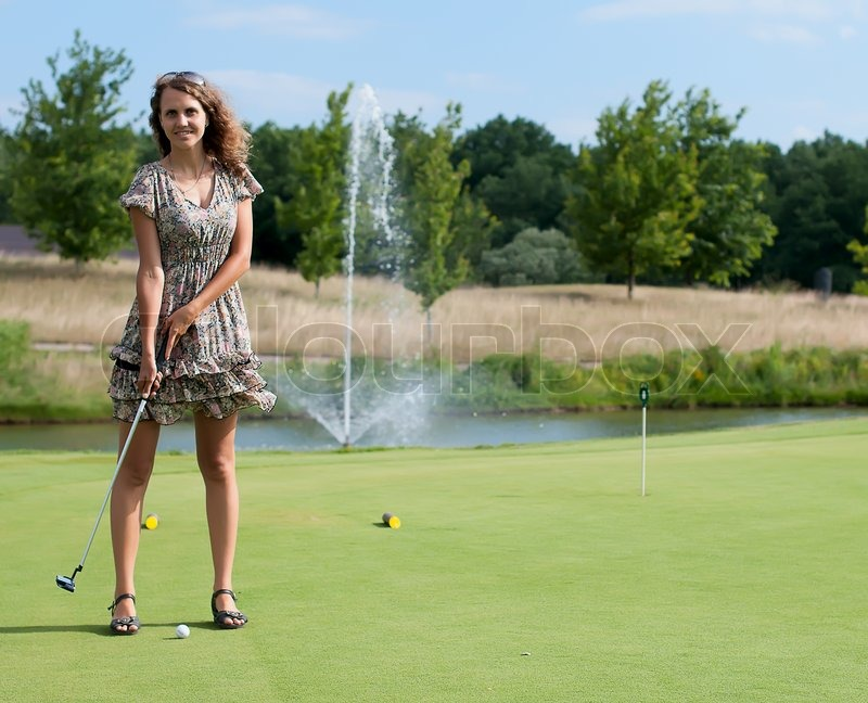 One Person Golf Cart >> Full length view of 5 year old girl swinging golf club | Stock Photo | Colourbox